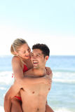 Beautiful man having girlfriend a piggyback Stock Photos