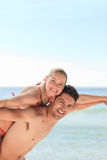Beautiful man having girlfriend a piggyback Royalty Free Stock Photos