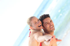 Beautiful man having girlfriend a piggyback Royalty Free Stock Photo