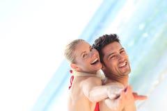 Beautiful man having girlfriend a piggyback. Beautiful young man having girlfriend a piggyback Royalty Free Stock Photo