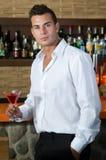 Beautiful man having a martini Royalty Free Stock Image