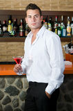 Beautiful man having a martini Stock Photography
