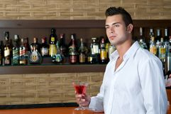 Beautiful man having a martini Royalty Free Stock Images