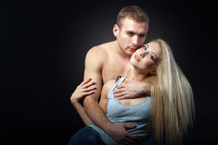 Beautiful man hugging a woman. isolated shot. Young men hugging the back of a beautiful woman. sensual love picture. couple dressed in jeans, a man's naked torso Stock Photography