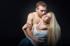 Beautiful man hugging a woman. isolated shot Royalty Free Stock Image