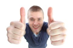 Beautiful man making ok sign with both hands Royalty Free Stock Photography