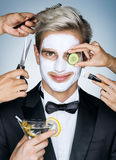 Beautiful man with moisturizing facial mask Stock Image