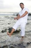 Beautiful man near the sea playing with water. Man near the sea playing with water Stock Photo