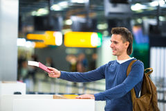 Beautiful man with passports and boarding passes Royalty Free Stock Photos