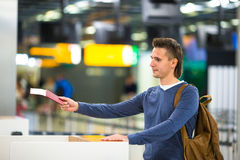 Beautiful man with passports and boarding passes Royalty Free Stock Image