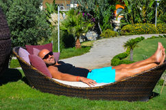 Beautiful   man    relaxing in a tropical garden Stock Photography