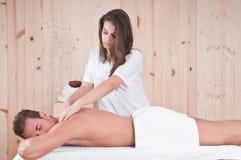Beautiful man in sauna getting massage relaxing Royalty Free Stock Photos