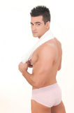 Beautiful man with slip and towel Royalty Free Stock Image