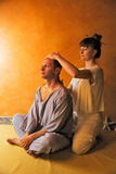 Beautiful man in spa salon having spa therapy with hands of masseur Royalty Free Stock Image