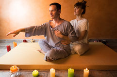 Beautiful man in spa salon having spa therapy with hands of masseur Stock Photo