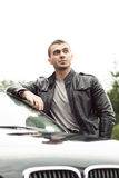 Beautiful man standing near by his car. Stock Image