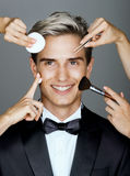 Beautiful man surrounded by the multifunctional service & x28;beautician and stylist& x29;. Stock Photography