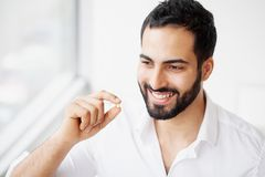 Beautiful Man Taking Pill, Medicine. Vitamins And Supplements.  royalty free stock images