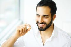 Beautiful Man Taking Pill, Medicine. Vitamins And Supplements.  stock image