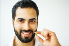 Beautiful Man Taking Pill, Medicine. Vitamins And Supplements.  royalty free stock photo