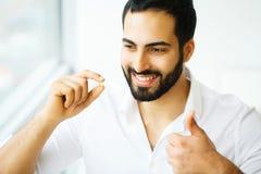 Beautiful Man Taking Pill, Medicine. Vitamins And Supplements.  stock photo