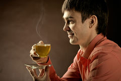 Beautiful man with tea Stock Photo