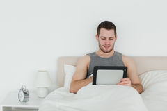 Beautiful man using a tablet computer Royalty Free Stock Photography