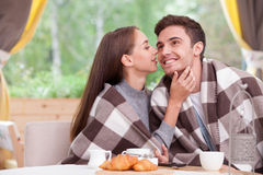 Beautiful man and woman are enjoying tea in Royalty Free Stock Photography