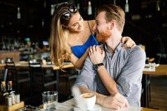 Beautiful man and woman flirt. Beautiful men and women flirt in cafe stock photography