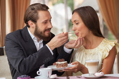 Beautiful man and woman are relaxing in cafe Royalty Free Stock Images
