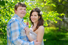 Beautiful man and woman walking in the flowering spring park Stock Photography