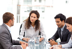 Beautiful manager speaking with her team Stock Images