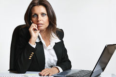 Beautiful manager woman at working desk Stock Images
