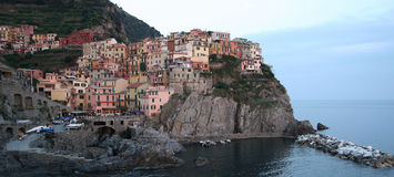 Beautiful Manarola fishing village at the twilight. Italy. It's one of five famous villages of Cinque Terre, suspended between sea and land on cliffs upon the royalty free stock image