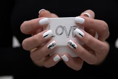 Beautiful manicure with a Cup of coffee. Love stock image