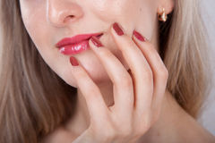 Beautiful manicure and lips close up Stock Image