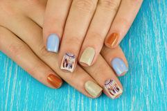 Beautiful manicure nails. Boho style. Beautiful female hands wit. H nails painted nails. Art manicure. Art manicure. Creative manicure. Taking Close-up nails royalty free stock image