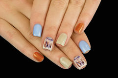 Beautiful manicure nails. Boho style. Beautiful female hands with nails painted nails. Art manicure. Creative manicure. Taking Close-up nails. Art nails. Nails royalty free stock photo