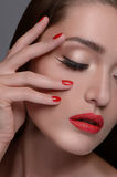 Beautiful manicure. Portrait of beautiful women touching face wi Royalty Free Stock Images