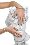 Beautiful manicure woman hands covering the eyes of an apollo st Royalty Free Stock Photography
