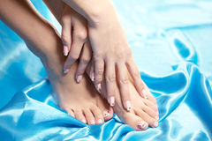 Beautiful manicured feet with a neat pedicure Stock Photography