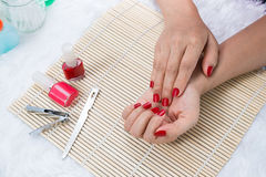 Beautiful manicured woman's nails with red nail polish Royalty Free Stock Photo