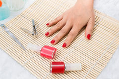 Beautiful manicured woman's nails with red nail polish Royalty Free Stock Image