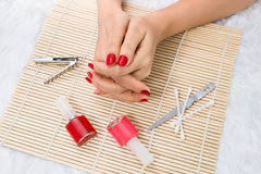 Beautiful manicured woman's nails with red nail polish Royalty Free Stock Photos