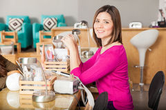 Beautiful manicurist at work Royalty Free Stock Image