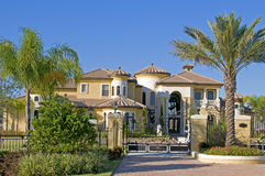 Beautiful mansion. With palm trees and blue sky stock images