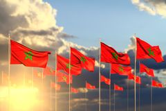 Nice any occasion flag 3d illustration - many Morocco flags on sunset placed in row with bokeh and place for your text. Beautiful many Morocco flags on sunset stock illustration