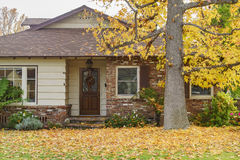 Beautiful maple tree with fall color in front of a house. Temple City, DEC 12: Beautiful maple tree with fall color in front of a house on DEC 12, 2016 at Temple Stock Images