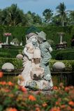 Beautiful marble statue of angels in the park in Thailand. Nice sunny summer day stock images