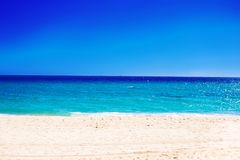 Beautiful marine view on Mediterranean  sea coast line with clea. N wavy water. Summer paradise Sandy beach at sunny day as natural background with blue sky Stock Images